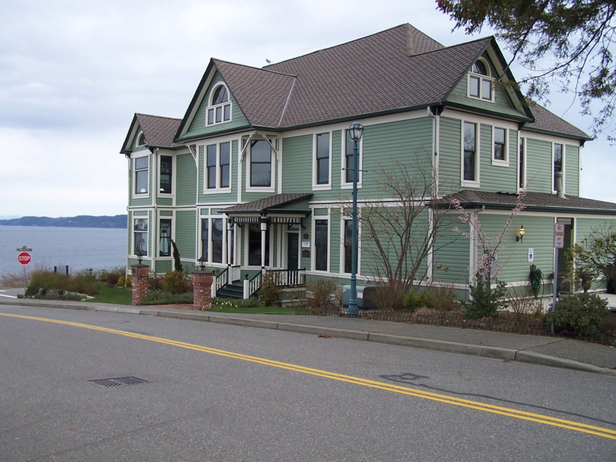Our sage green mansion on the corner of Little-Known Traffic and Gentle Waves