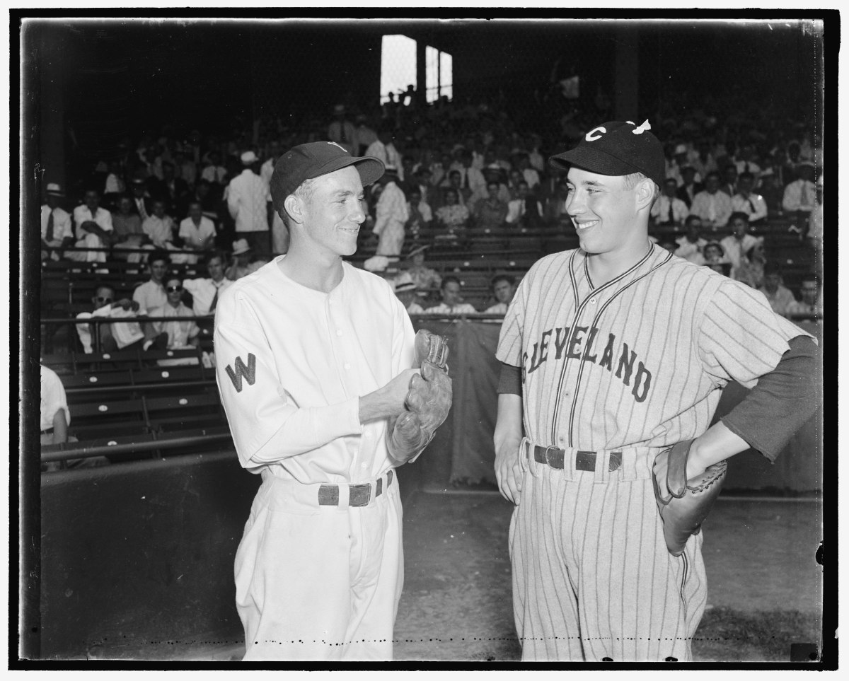 Cleveland Indians pitcher Bob Feller (right) meets with Washington Senators pitcher Bucky Jacobs prior to a 1937 matchup. The two youngsters were among the most highly touted pitchers at the time but only Feller would continue on to become a legend.