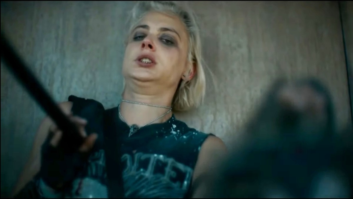 Zombie leader attacks that short hair girl. He kills that girl. Because I have told you that how fast he was.