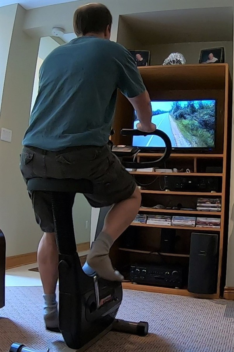 Exercise bike workout while watching a cycling video of me biking around a park.