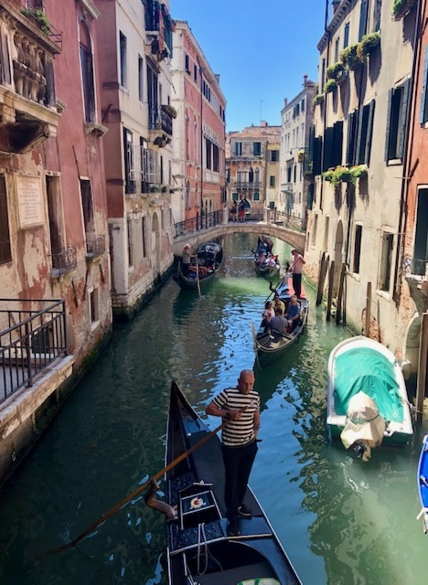 A Leisurely Gondola Ride in the Narrow Canals of Venice