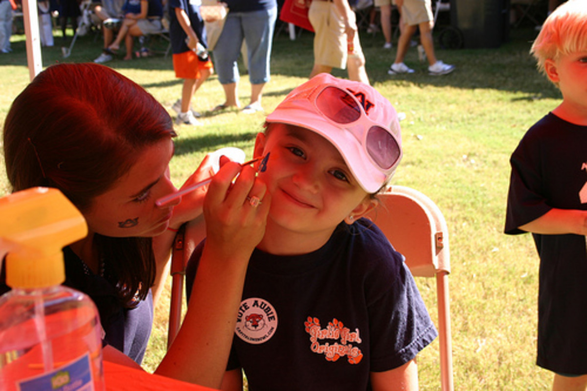 Face painting is a fun way to pass the time before the game and to show your team spirit.