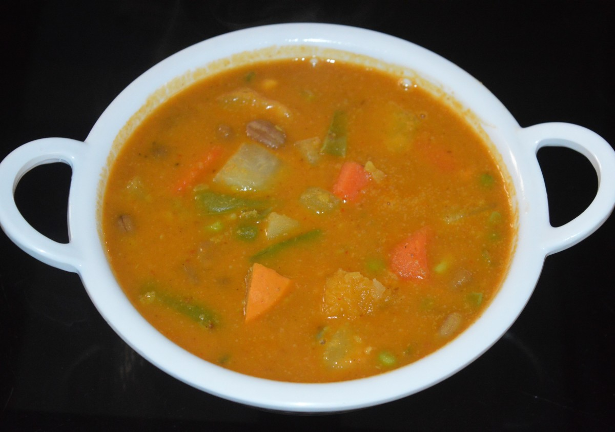Udupi-style vegetable kootu is ready! Add tempering as per instructions. Mix well.
