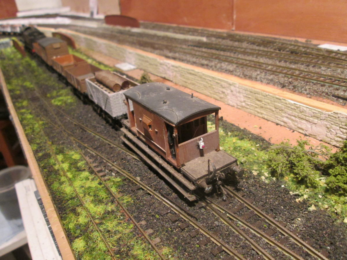 Guard's van passes the photographer on its way at the train's tail to Unit 3, with bridge side walls over underground wartime factory unit. At the back a lighter ballast mix has been fixed down and will form the basis of the main running lines