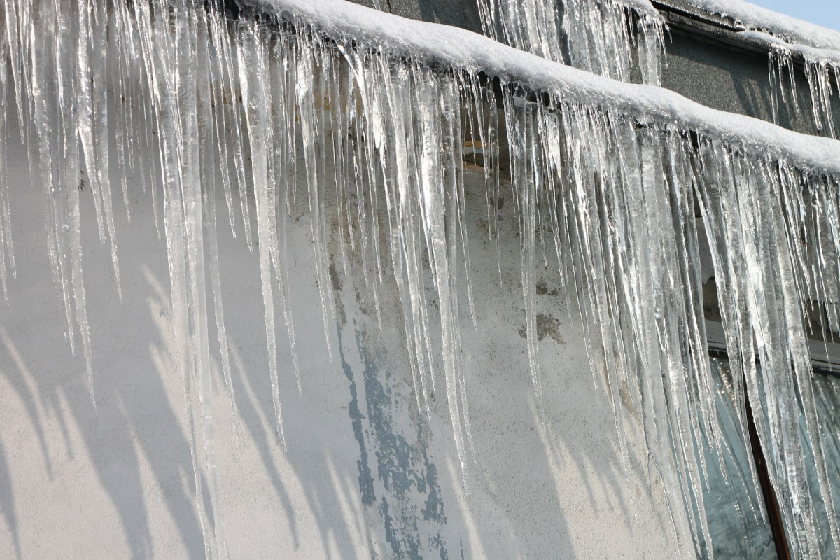 A buildup of ice around the edges of your roof can cause an ice dam, water backing up behind it and seeping through the gaps in your roof tiles.