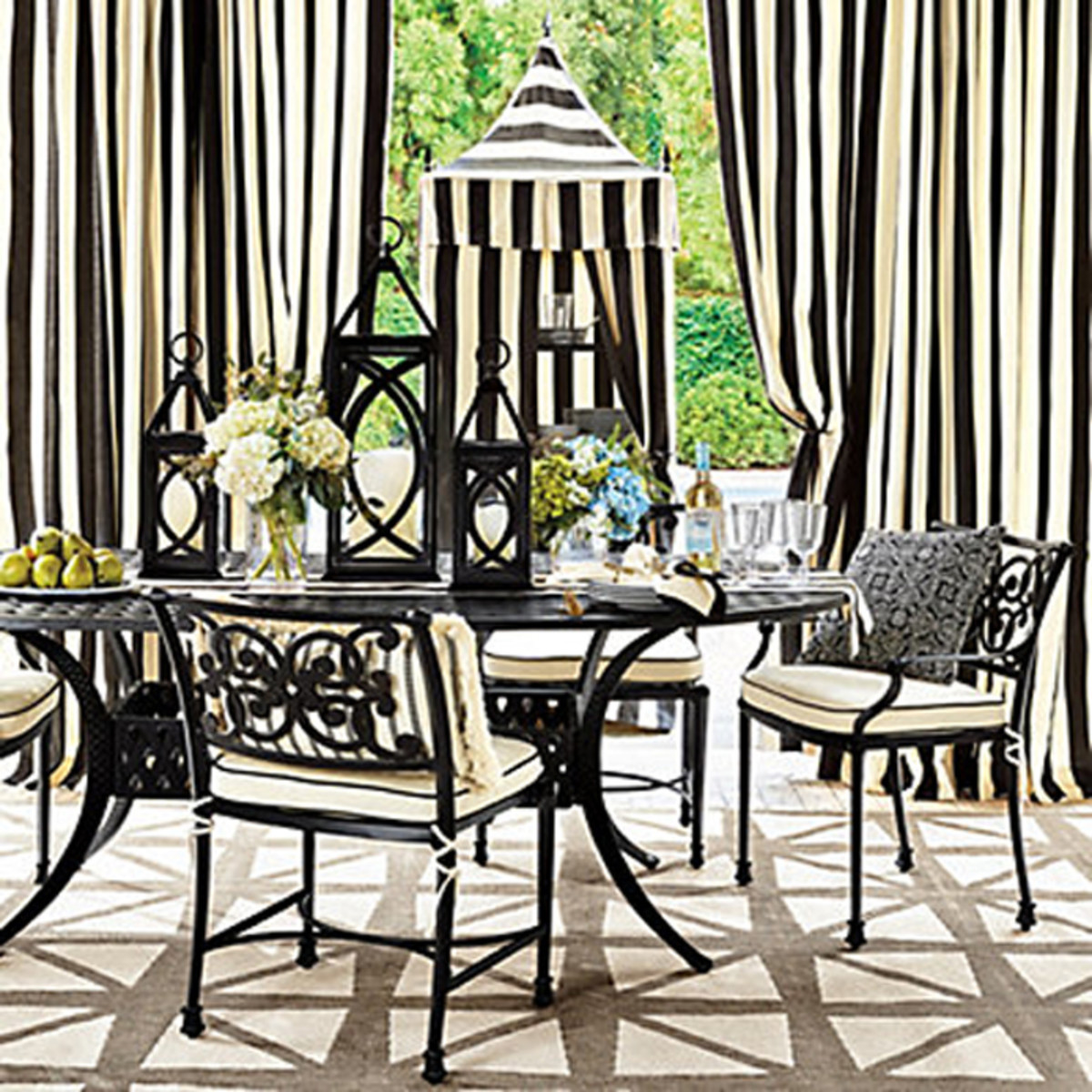 Black-and-white curtains add pizzazz  to your patio and pool area.