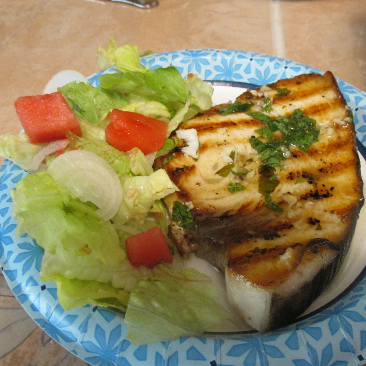 Grilled swordfish with a side salad
