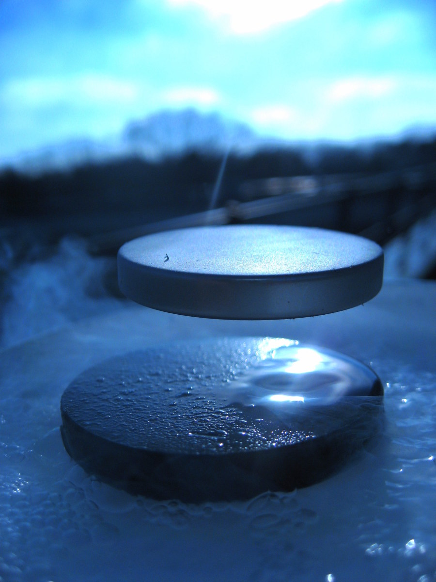 A superconductor levitating the permanent magnet.