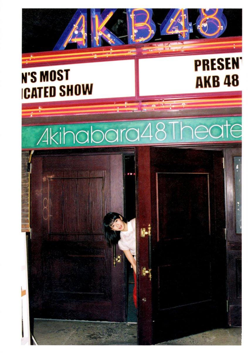 Atsuko Maeda standing right near the entrance to the famous AKB48 Theater.