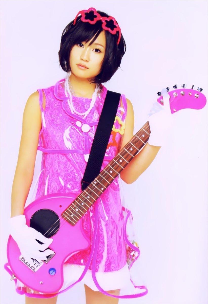 Is Atsuko Maeda getting ready to play bass guitar?