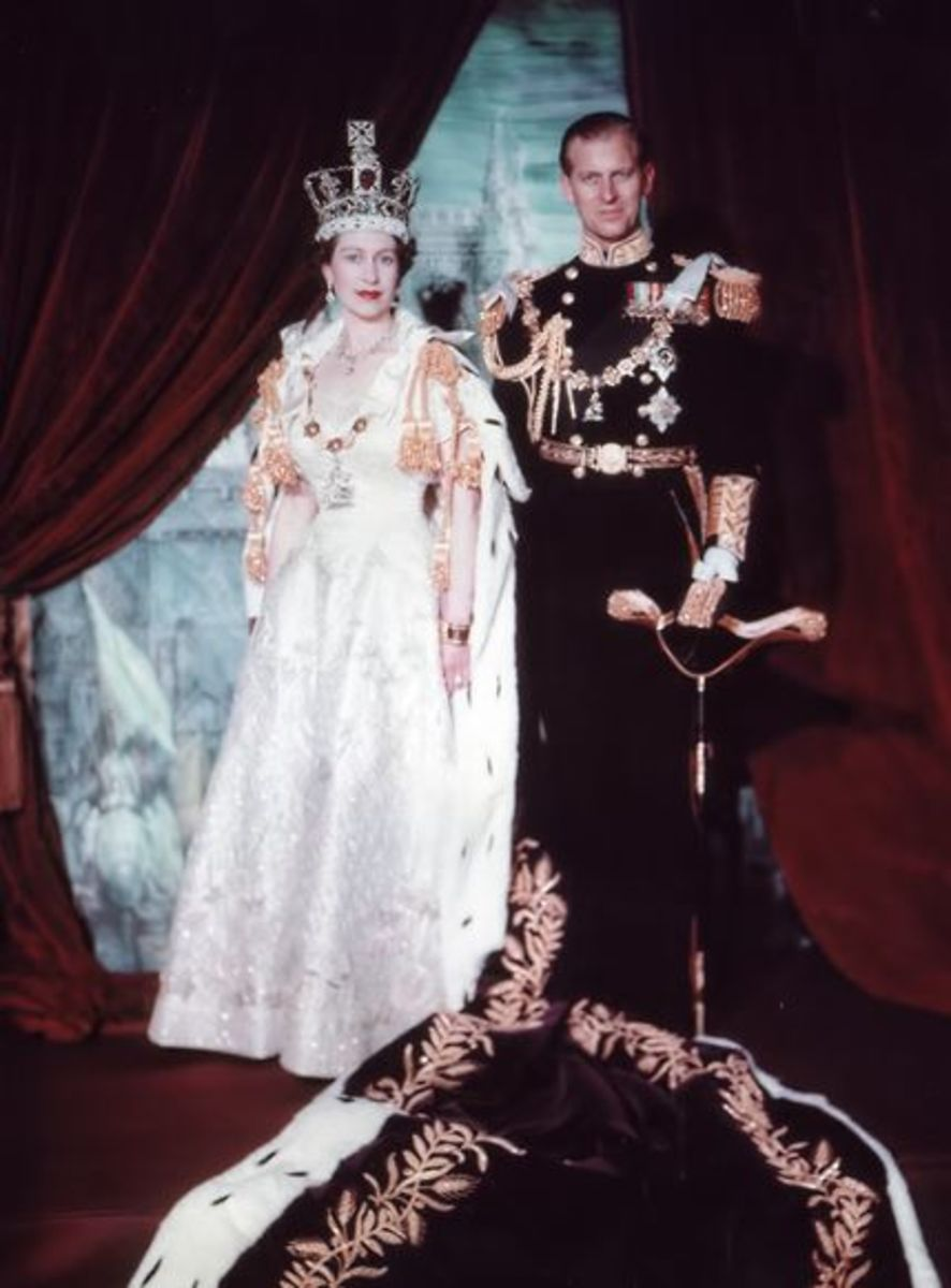 A photograph from 2nd June 1953 taken after Elizabeth II's coronation. She is shown with Prince Philip (1921-2021) and wearing the Imperial State Crown.