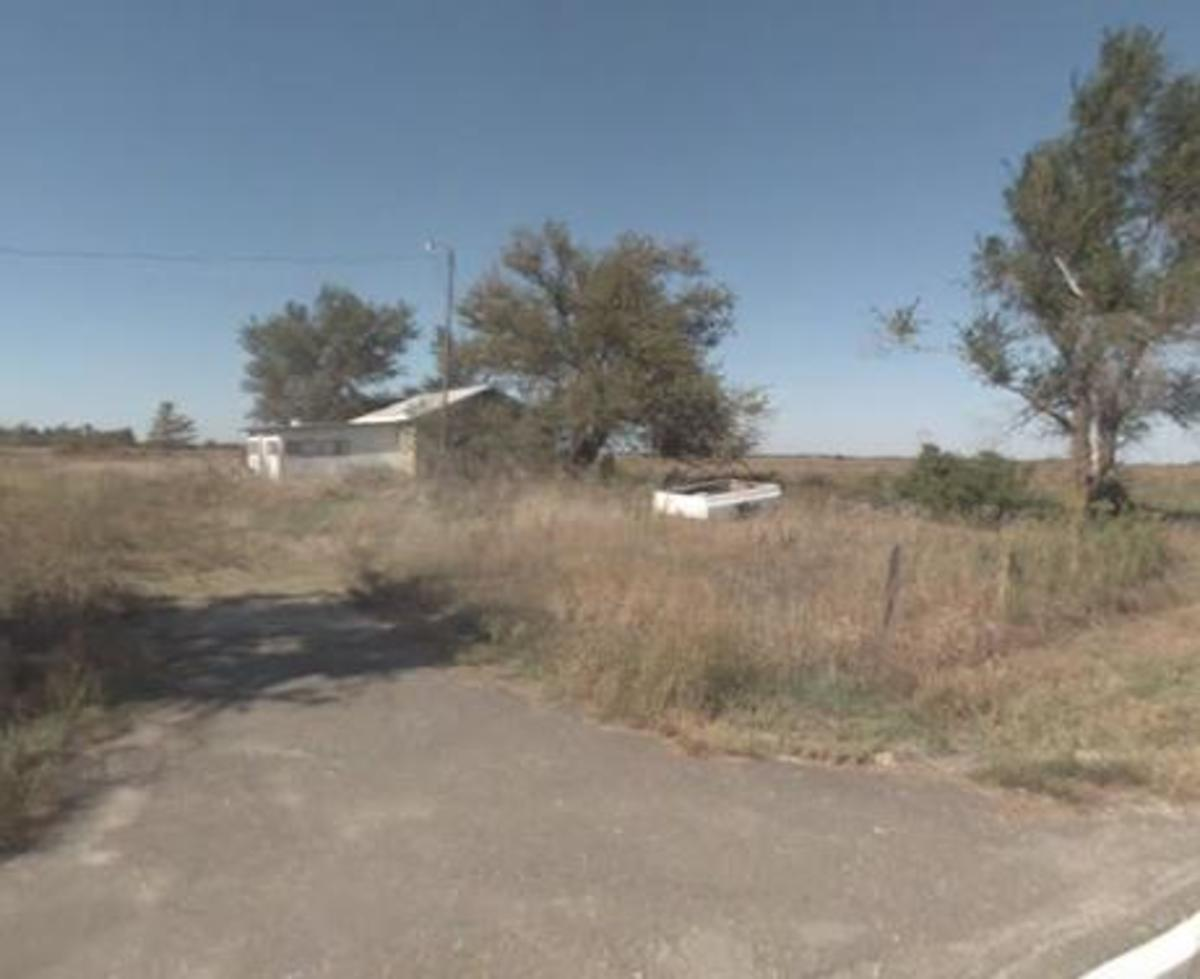 It was on this parcel that a Farmer's Coop was built. It was a cinder block building, fairly long, housing a business that sold cattle feed and other farm necessities. It was razed a few years later, and a home built. It appears now, to be abandoned.