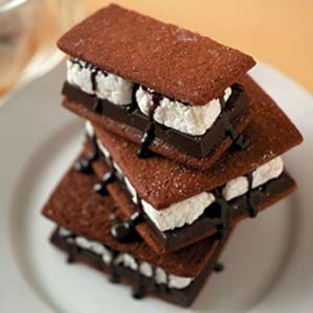 Dress up your S'mores by drizzling melted chocolate over the marshmallow and chocolate bar.