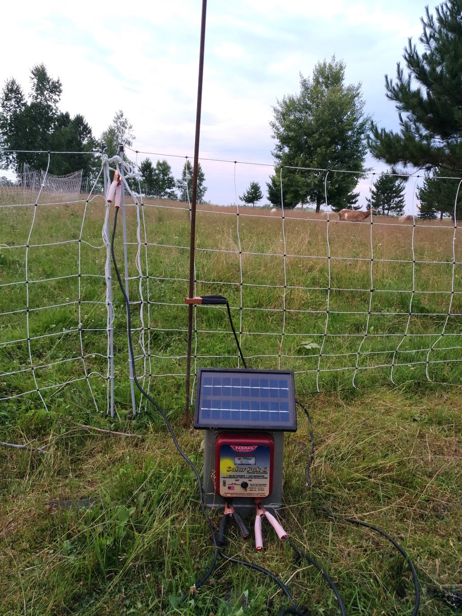 This is the complete set-up for making a portable electric net fence hot. Note the copper ground rod.