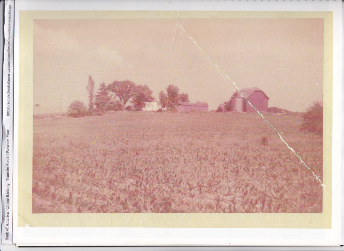Our rented farm on the hill.  Picture taken about 1955