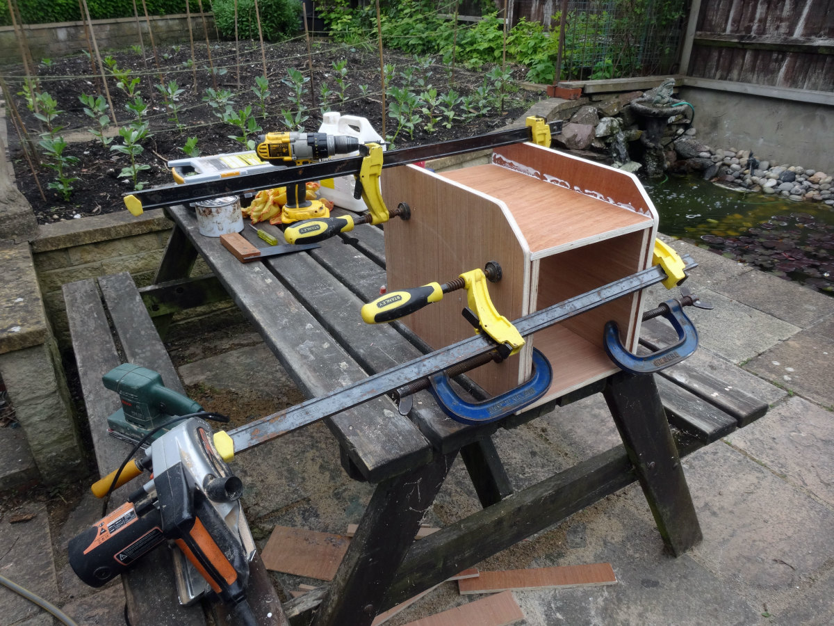 All four pieces glued and clamped together, and ready for screwing; with the sacrificial spacers in place to temporarily support the top at the correct height during assembly.