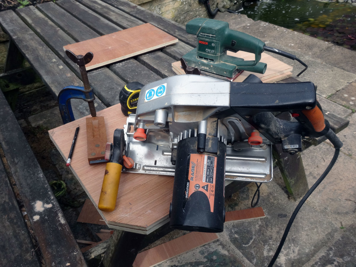 Using a circular saw to cut the bevelled edges to the front of the top filing tray.
