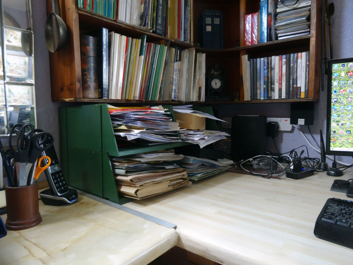 The short stubby green filing trays that we're keeping; and which I based my measurements on form designing the new wood filing trays.