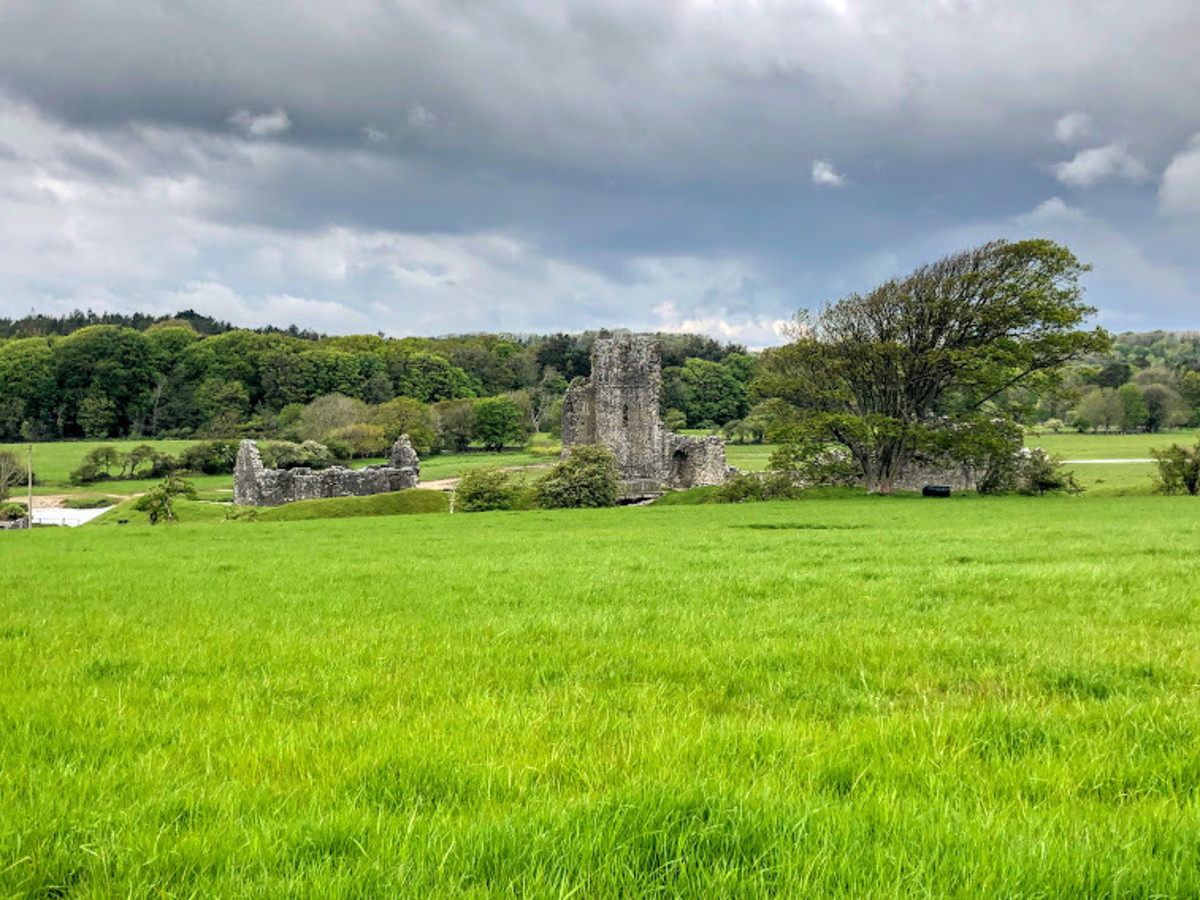 View of Ogmore Castle from the trail. Head 3 minutes off the trail to see the ruins and famous stepping stones.