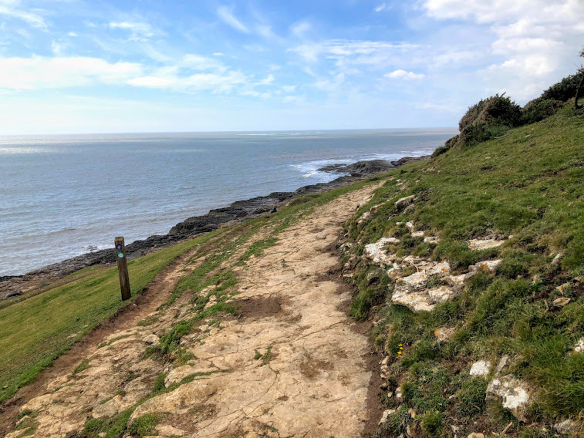 Following the Wales Coast Path signs back to the car park and the end of the walk.