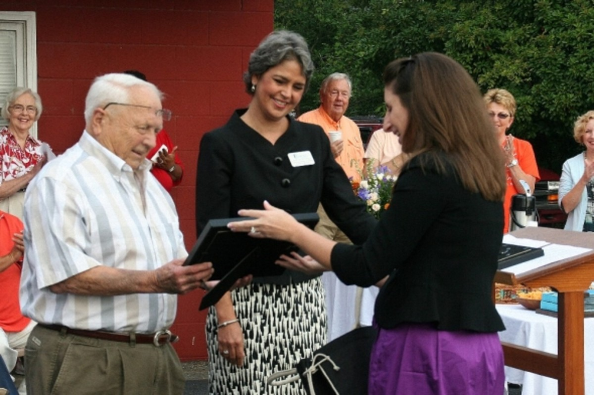 Candace Gillespie and Peggy Hotchkiss of MUSC present Doc Hellams with a gift