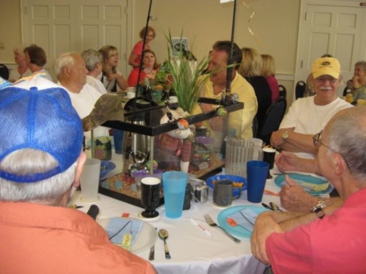 Doc Hellams Spring Brunch Doc had an aquarium in the middle of his table and inside the tank was all kinds of fun fishing stuff including 2 live fish. He had fishing poles coming out of it with a big fish balloon rising able it. He had favors for his