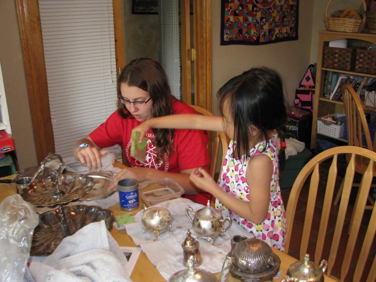 polishing silver for a tea party