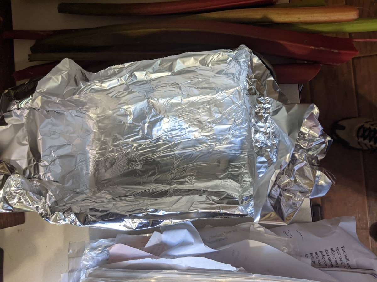 Aluminum foil. Bend over outside to make it fit inside.
