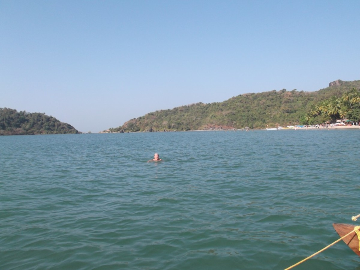 A tourist enjoys swimming