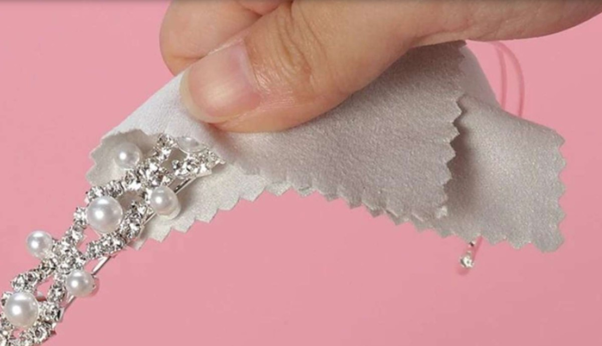 Use only a jeweler's cloth or microfiber towel to polish sterling silver.