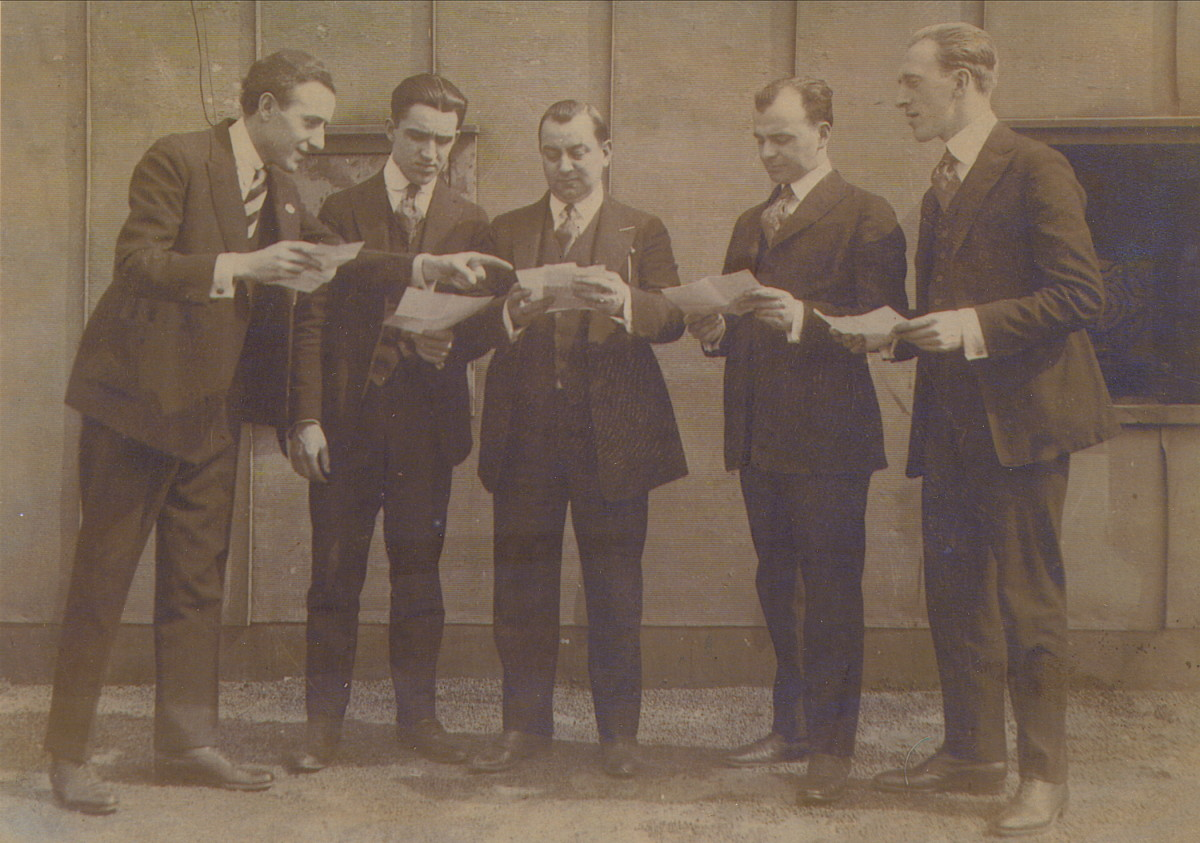 The Louisiana Five looked over their musical contracts. Some of these gents may be doing the same for their next life times, now.