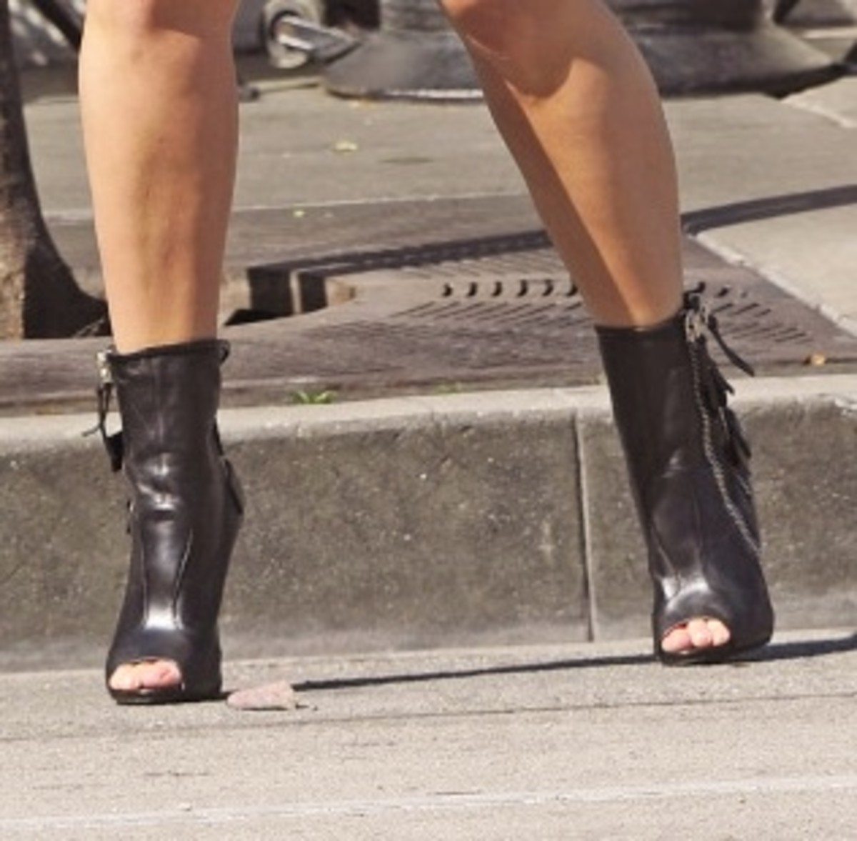 Peep-toe black leather heel boots