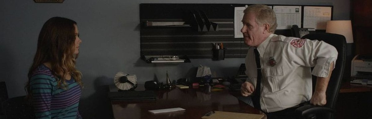 Joan Conroy (Gina Holden) submits her resignation to Chief Caldwell (Robert Pike Daniel) before learning that her daughter is trapped in a sink hole