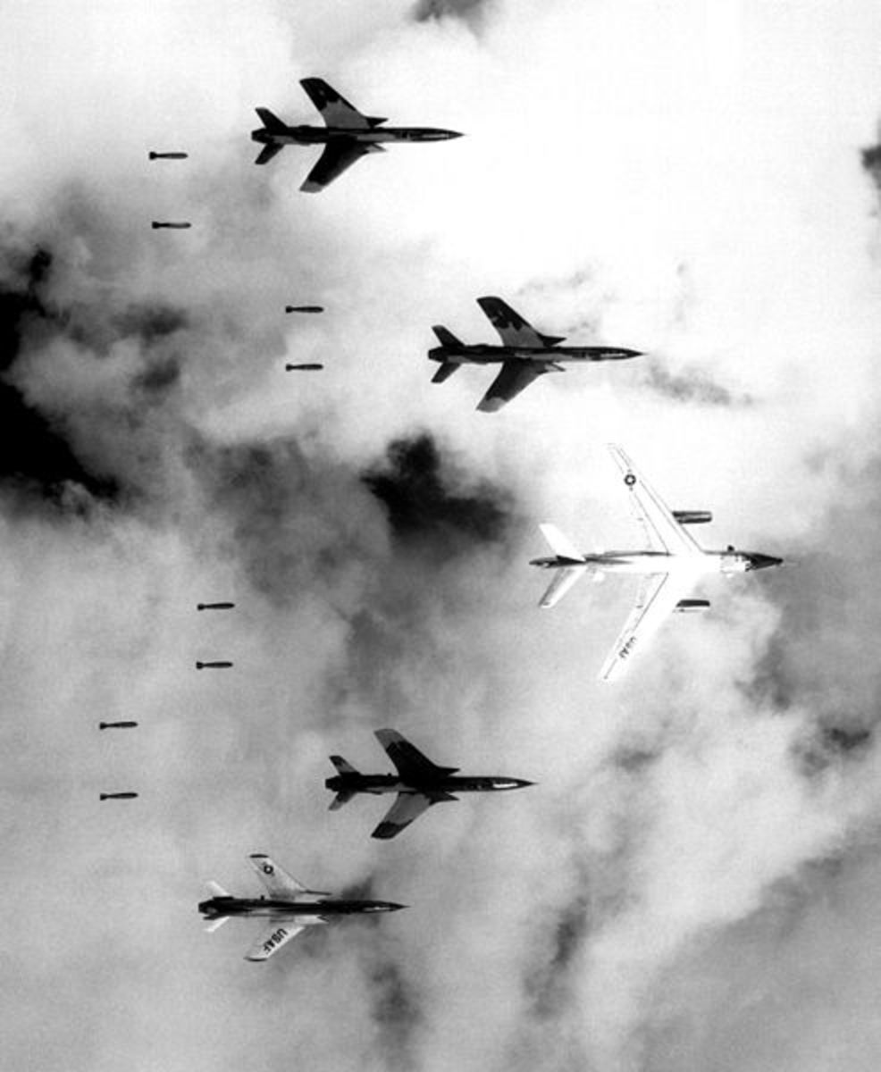"""Flying under radar control with a B-66 Destroyer, Air Force F-105 Thunderchief pilots bomb a military target through low clouds over the southern panhandle of North Viet Nam. June 14, 1966"" - Colonel Cecil J. Poss, 20th TRS USAF (National Archives)"