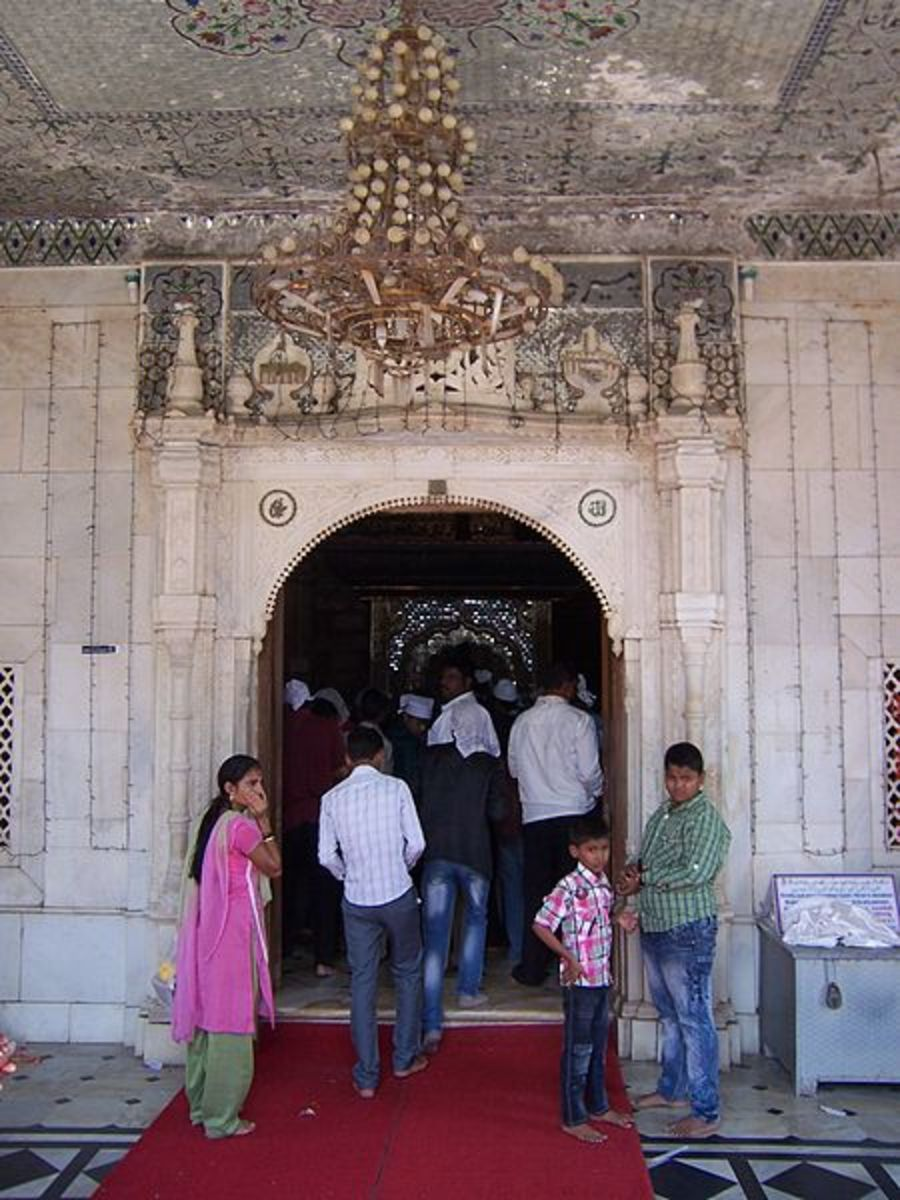 Covering your head with towel, you can enter the Dargah. All are welcome here.