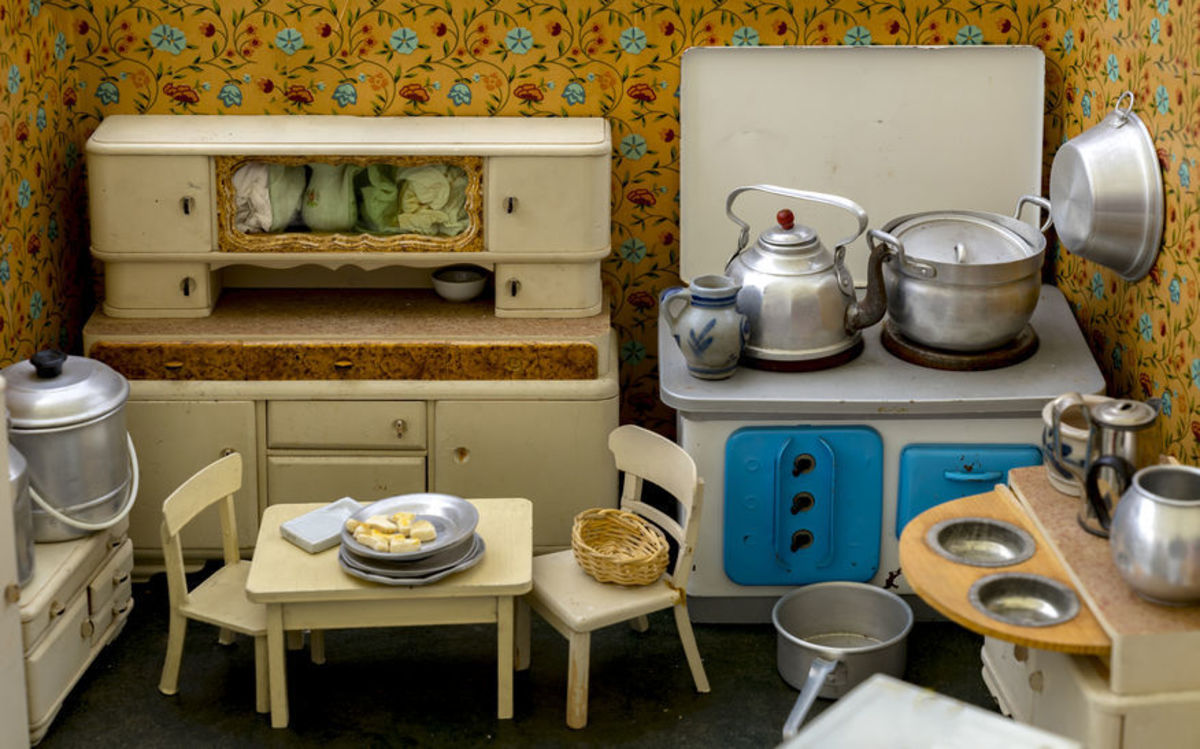Vintage miniature home's kitchen with everything a young girl needs to practice cooking, cleaning, and organizing.
