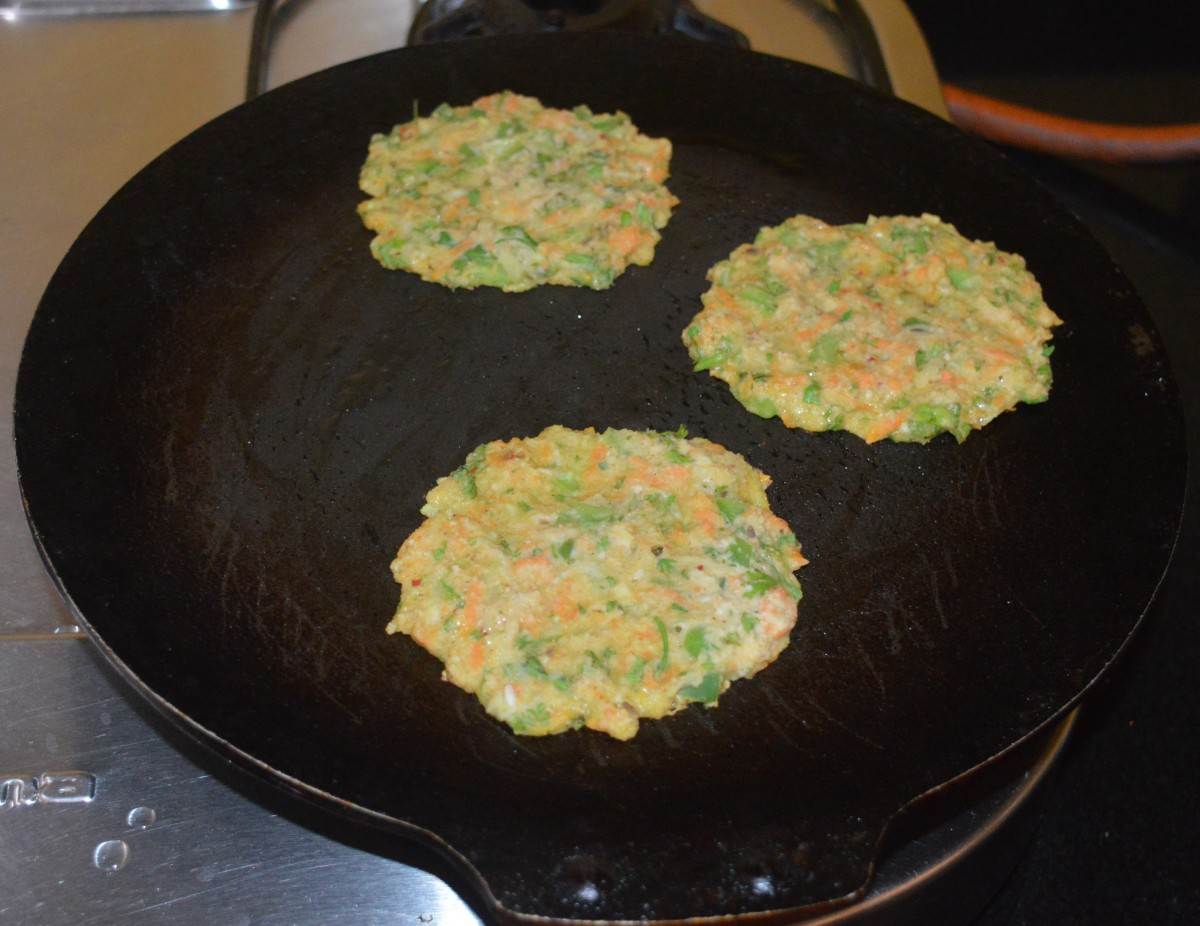 Add a few drops of oil to the top of each of the cheela. Cover it for fast cooking.