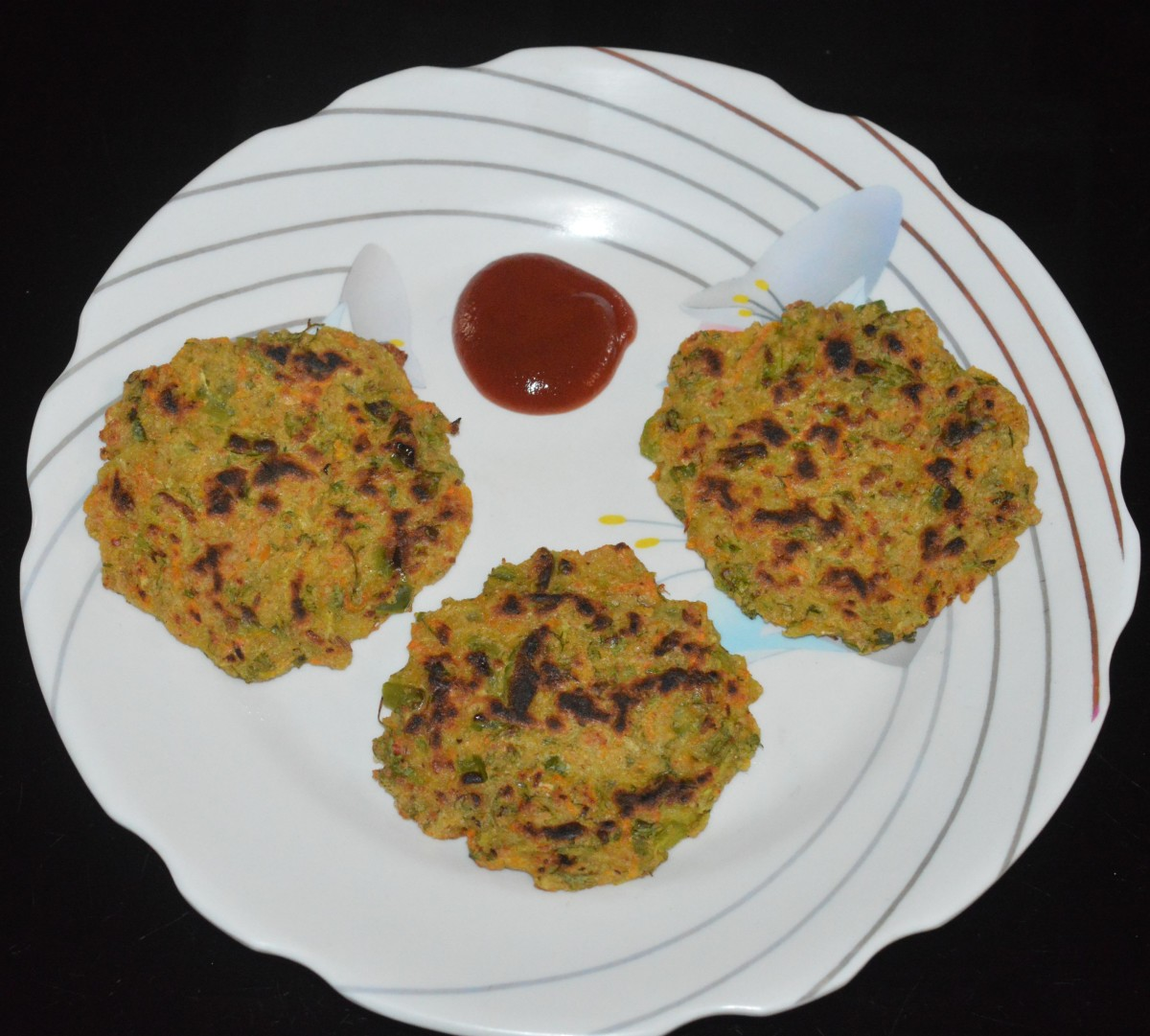 Make more cheela with the remaining batter. Serve them hot with coconut chutney, pickle, or tomato sauce. Enjoy eating them for breakfast or dinner.