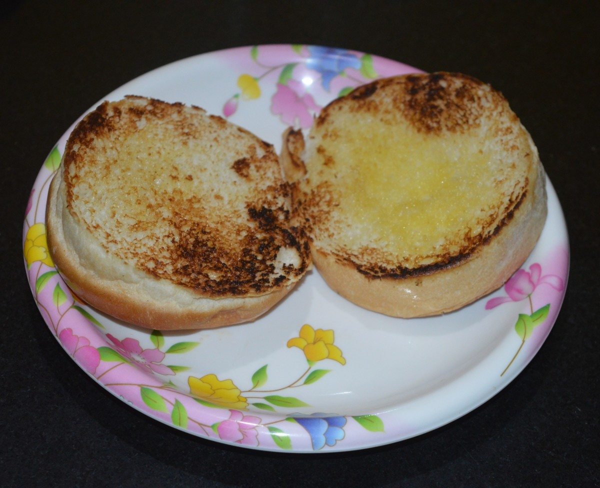 Toast both slices with butter