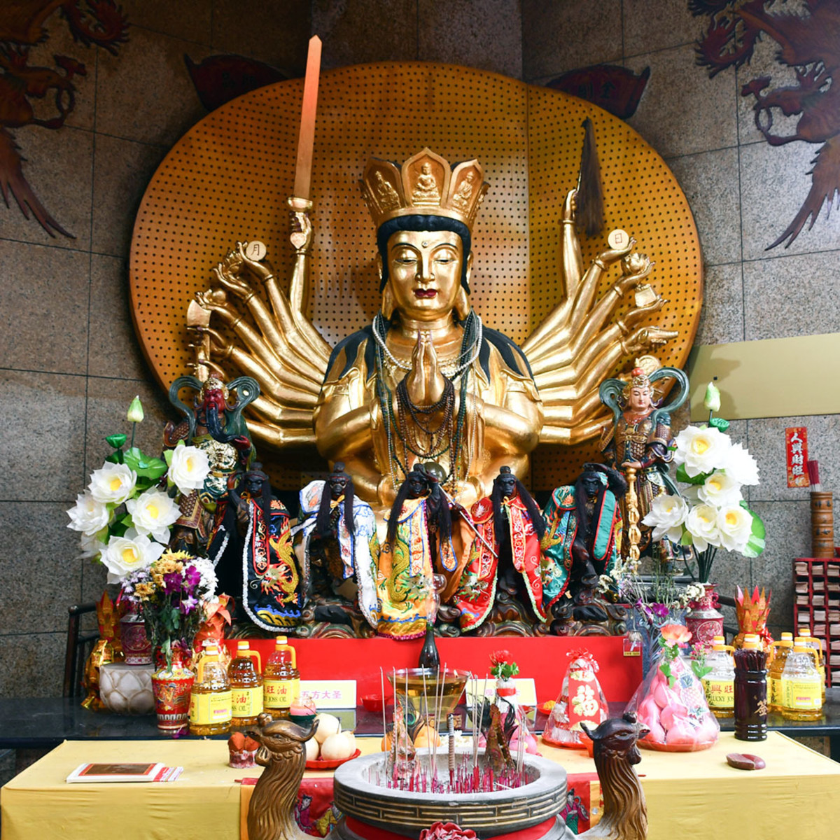 """In Chinese temples, Guanyin is often depicted as having a """"thousand arms"""" i.e. qiānshǒu (千手). This is itself a great term to use when naming techniques that execute a flurry of strikes."""