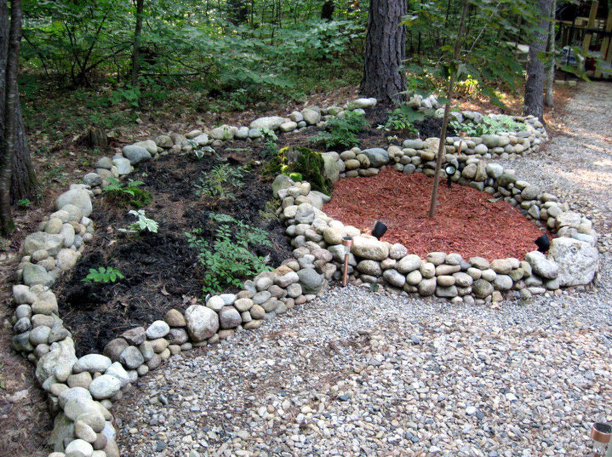I gather rocks and construct these stone borders for my planting areas.