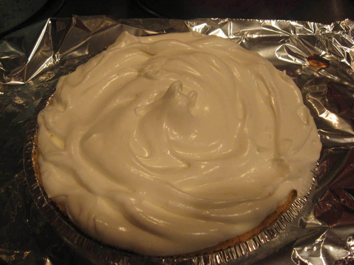 Spread meringue on pie and seal to crust.