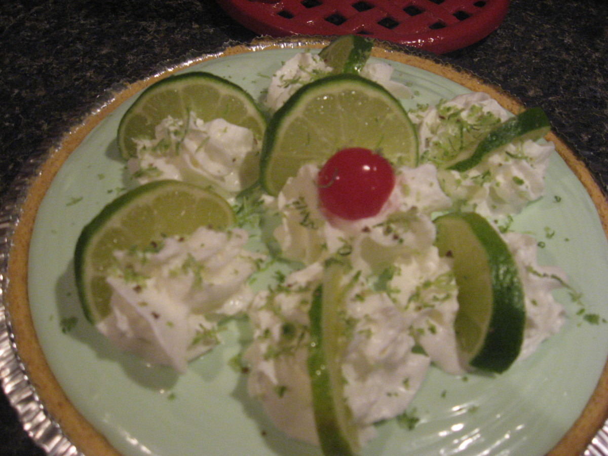 Add whipped cream, lime slices, lime zest, and/or cherries.