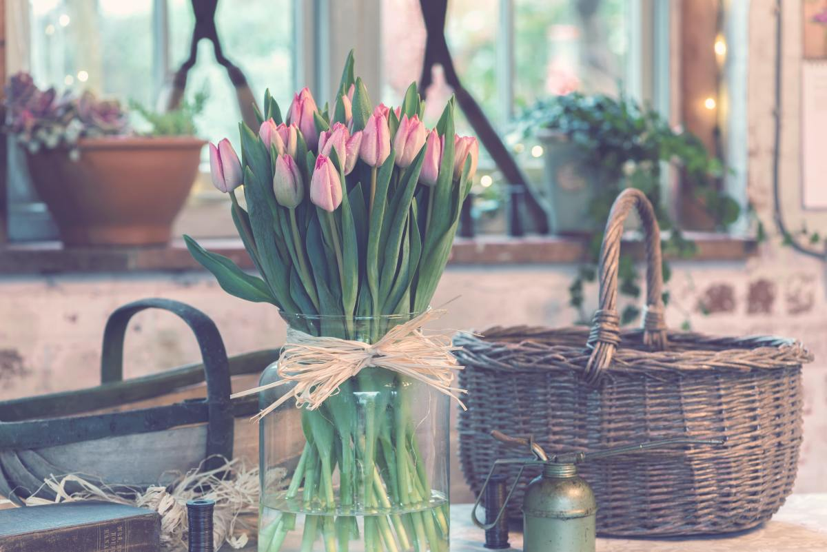 Flowers in a wicker basket add so much to any room.