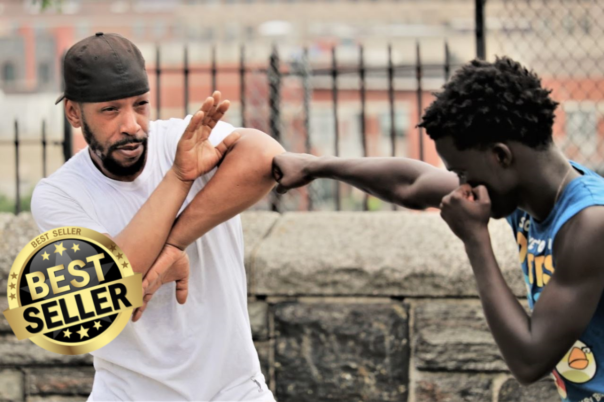 Lyte with a student learning the techniques in the 52 Blocks style.