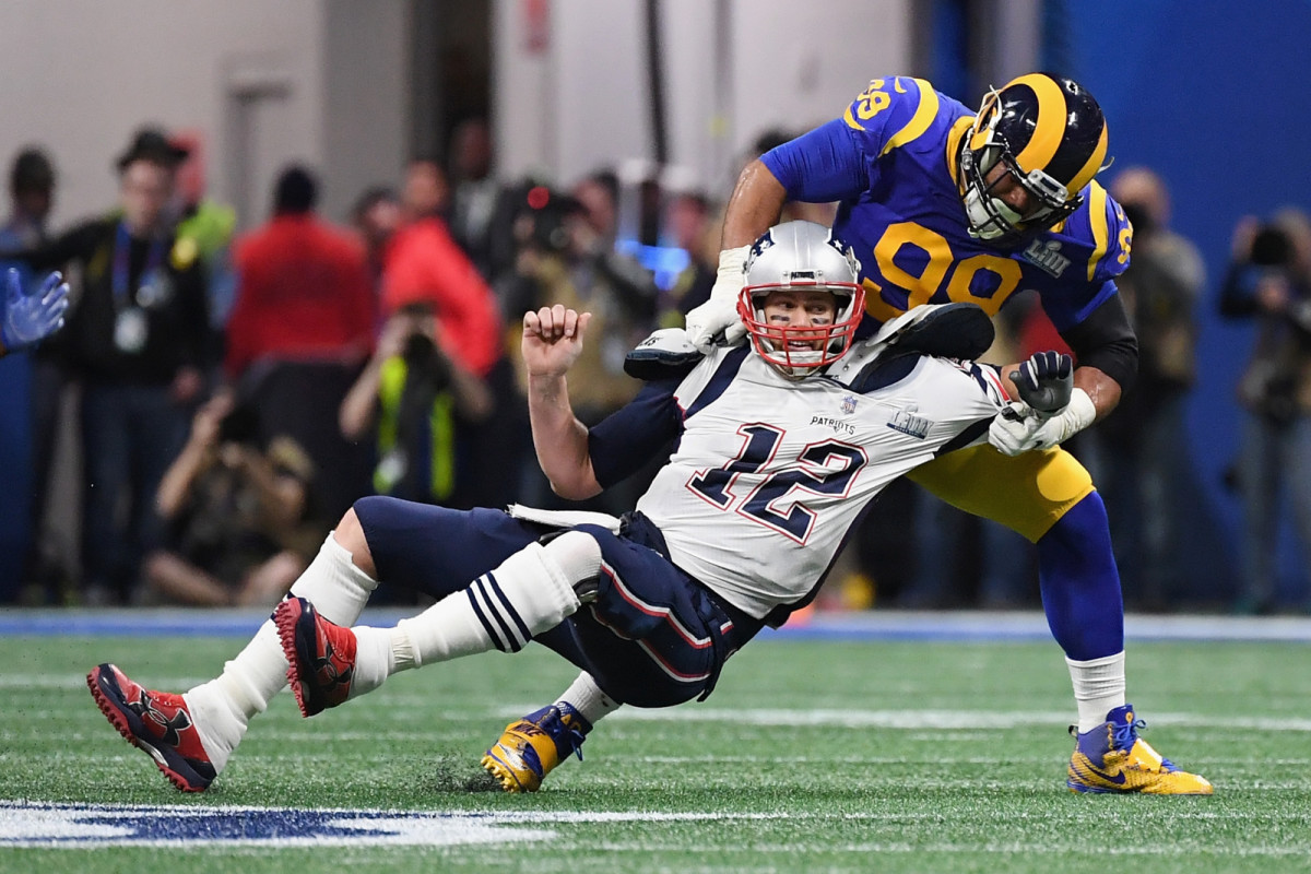 Aaron Donald swings Tom Brady to the ground.