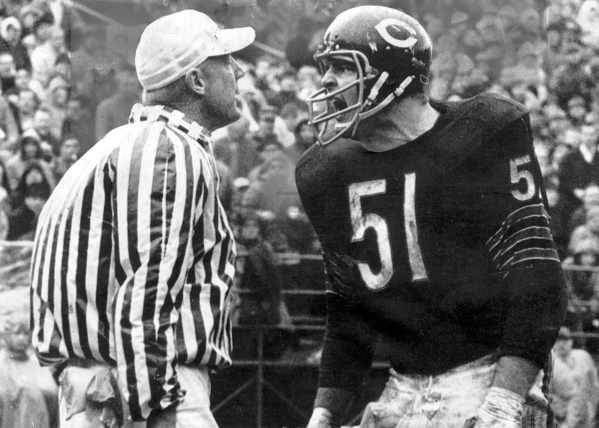 Dick Butkus yells at a referee during a game.