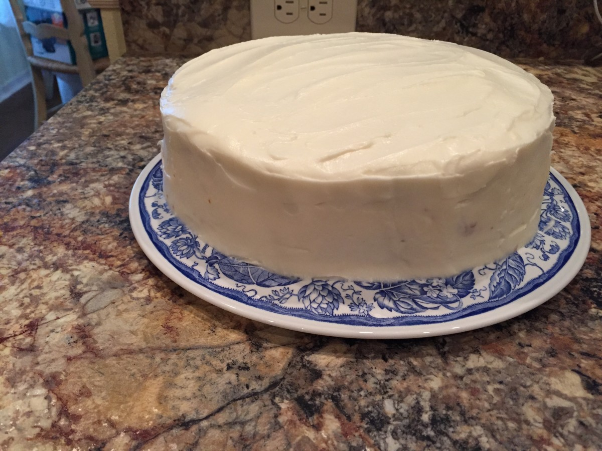 Smoothed icing can be left as it is, or be decorated with chopped pecans either on top, on the sides, or both.