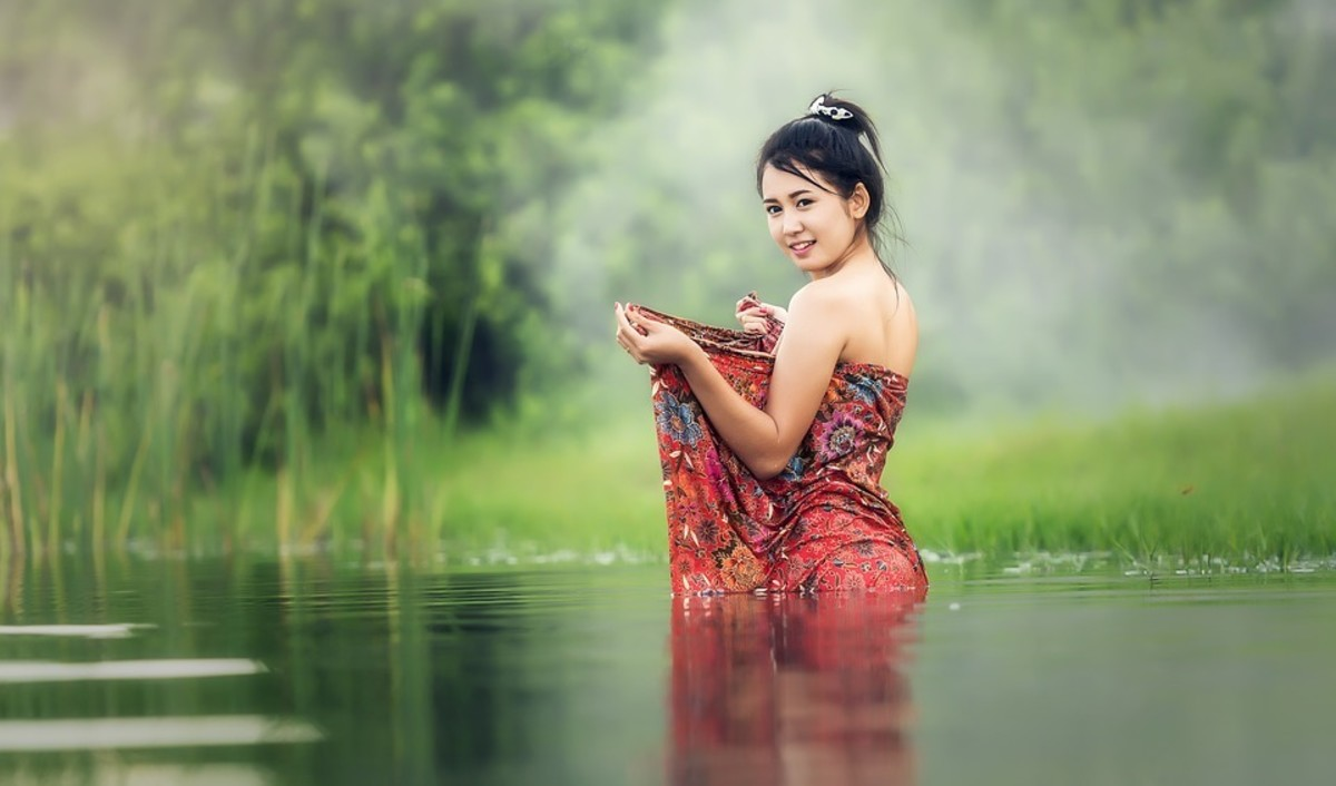 Woman washing in Vietnam and living a simple lifestyle.