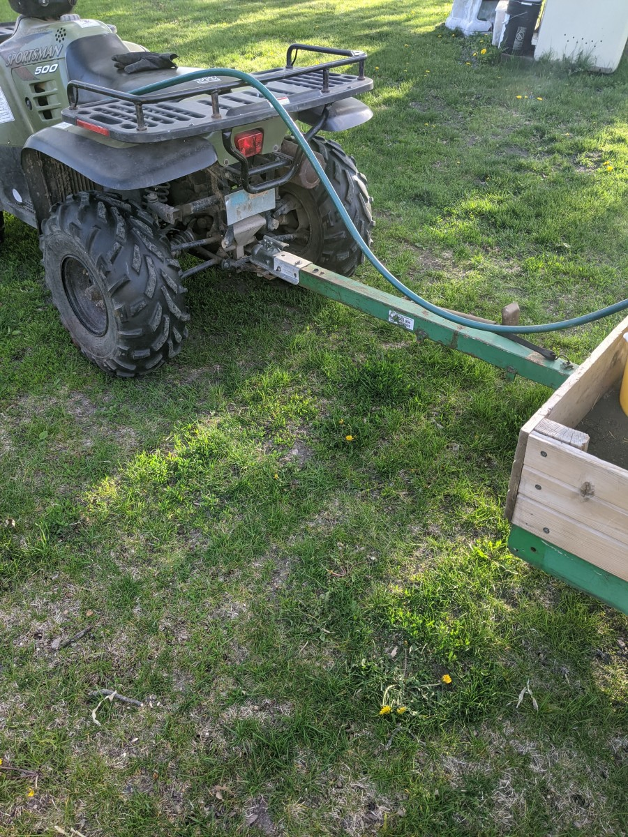 tree-watering-using-4-wheeler-and-barrel
